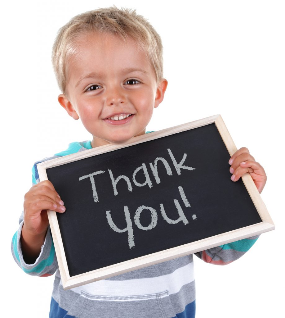 Child with Thank You Sign